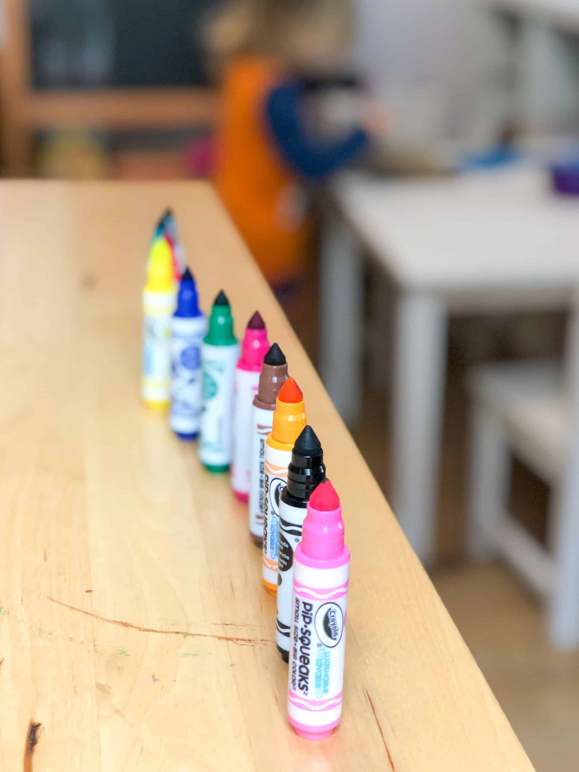 Summer bucket list ideas - colouring pencils and toddler creating