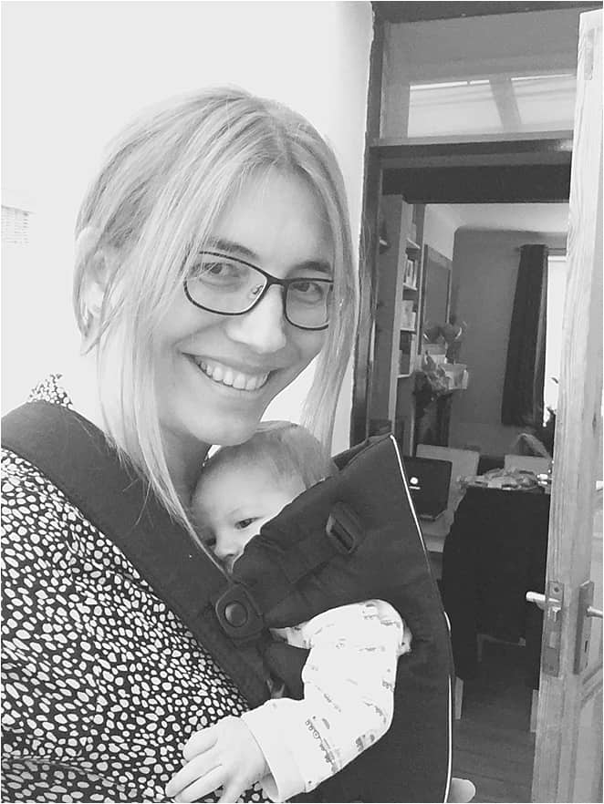 Baby travel essentials - baby in a sling