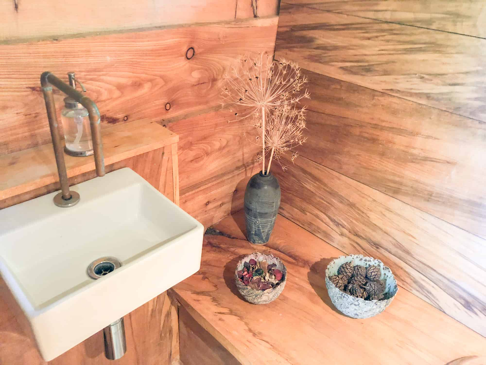 Glamping packing list article - running water and soap standard for glamping